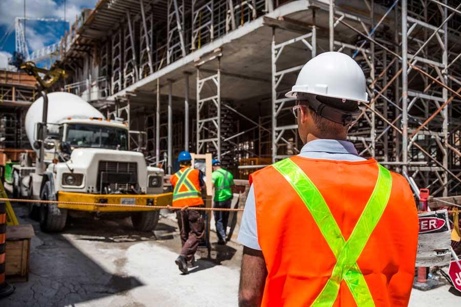construction site supervision orange vest