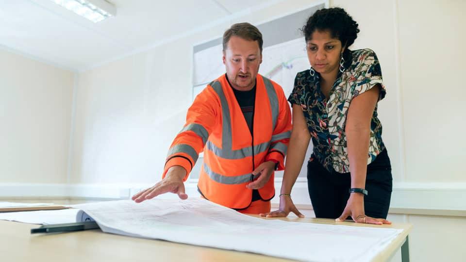 engineers looking over blueprint